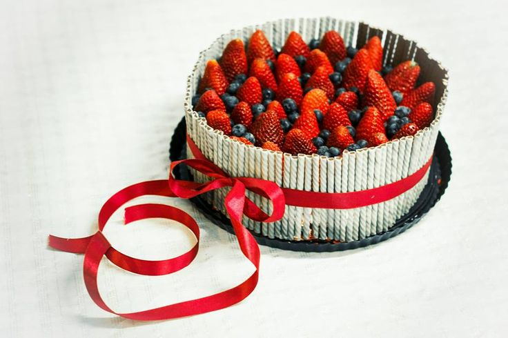 Cake with chocolate stick and fruits