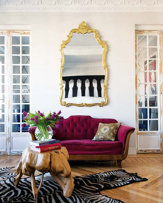Madrid And Venice Style, Burgundy Couch, White Walls With Molding, Gold  Trim,
