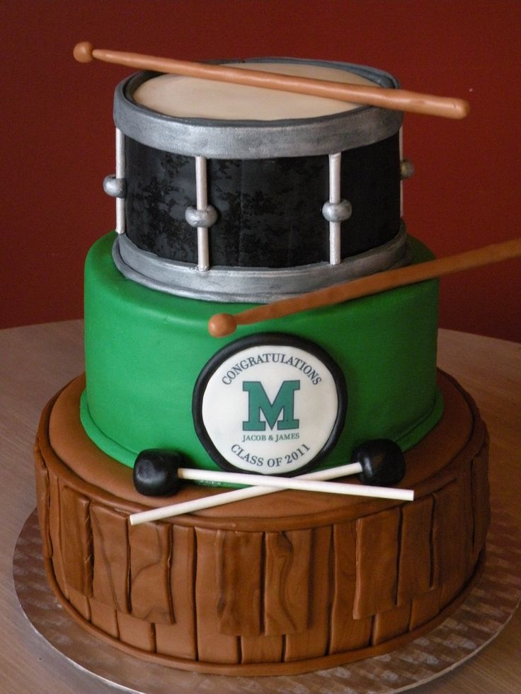 Drum line-themed graduation cake - High School Graduation cake - The 2 graduates were in the drum line and played both the marimba and the snare drum so they wanted that to be the theme of the cake. Everything is edible except for a few lollypop sticks.