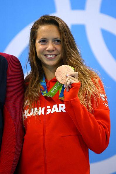 Boglarka Kapas of Hungary celebrates on the podium after winning bronze in the…