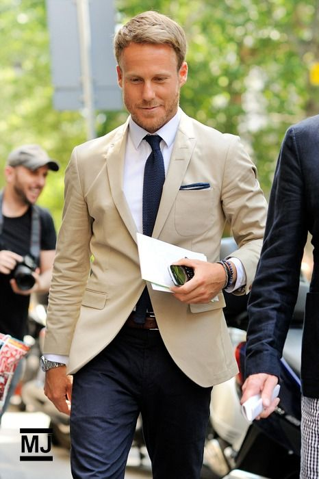 Tan suit with blue mens pants. Matching tie and pocket square.