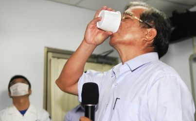 """Bottoms up! Boss of 'gutter oil' firm drinks cup of cooking oil to prove it is safe. The pin link to CSR and ethics. Taiwan was broke """"gutter oil"""" scandal. Unethical companies use recycled waste oil to produce edible oil. Someone's business owners have used this approach to restore the corporate image."""