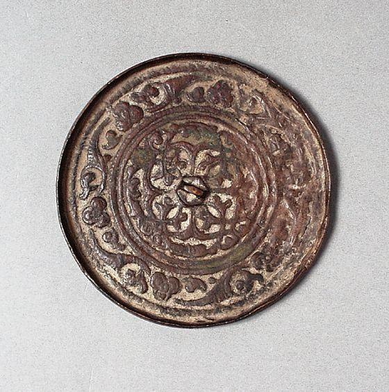 Mirror Afghanistan, 12th-13th century Bronze Diameter: 3 3/8 in. (8.6 cm)