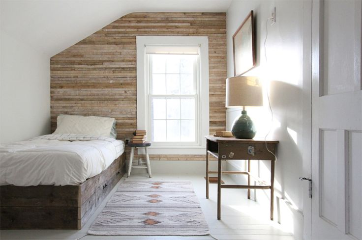 {wooden slat wall} creates instant texture and visual interest in what would otherwise feel like a bare and stark room. #lakehouse #farmhouse