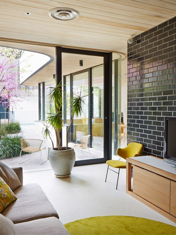 Clare Cousins and Ben Pederson's Home | View from TV room / play room to living room, vintage penguin chair from CodeNameTom| Photo - Sean Fennessy | Production – Lucy Feagins / The Design Files