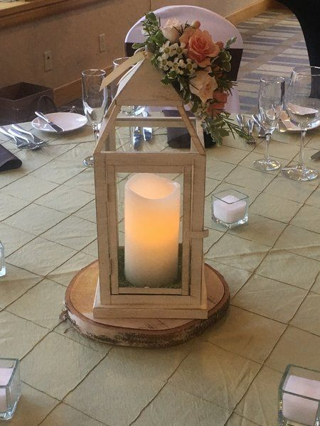 Wedding flowers - wedding lantern-  A beautiful classic lantern with an LED pillar candle nestled on moss and a pretty floral accent.
