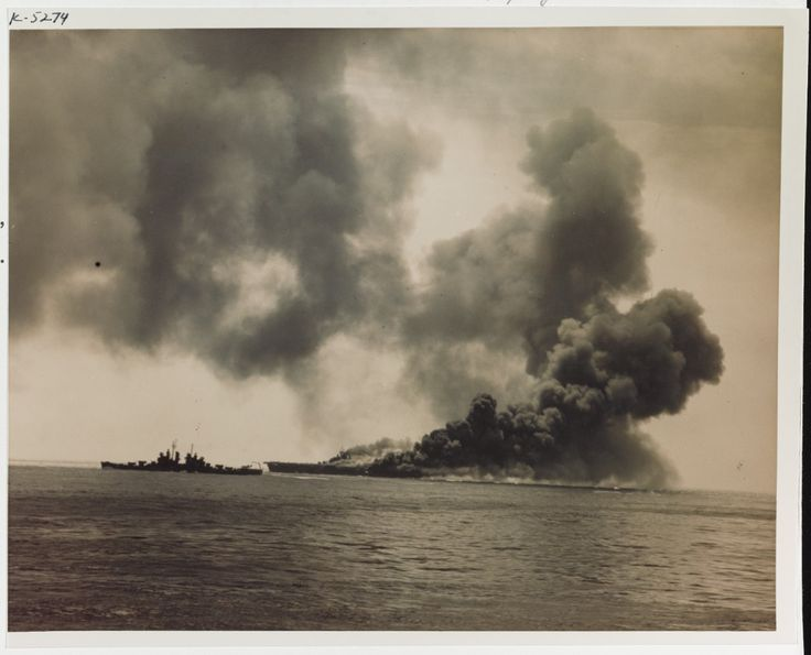 USS Bunker Hill (CV-17) Burning after being hit by Kamikaze suicide planes during the Okinawa operation, 11 May 1945. A Cleveland class light cruiser is steaming nearby, at left. Official U.S. Navy Photograph, now in the collections of the National Archives. #: 80-G-K-5274