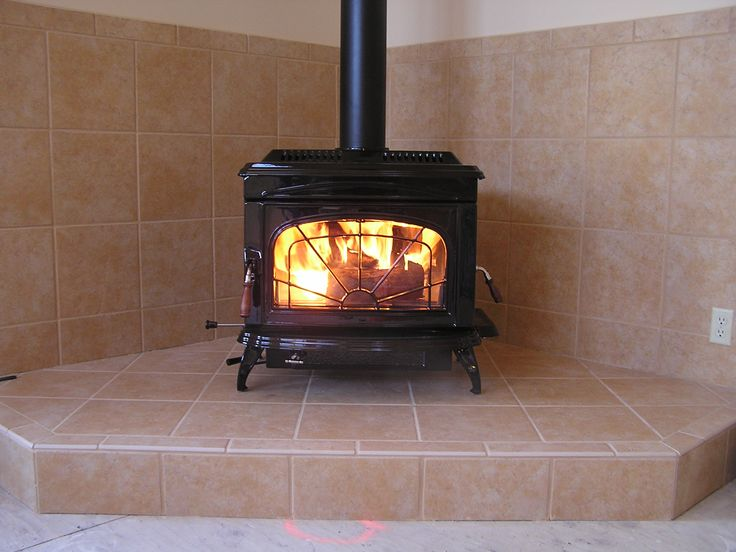 Freestanding Wood Burning Stove - Wall protection and hearth.
