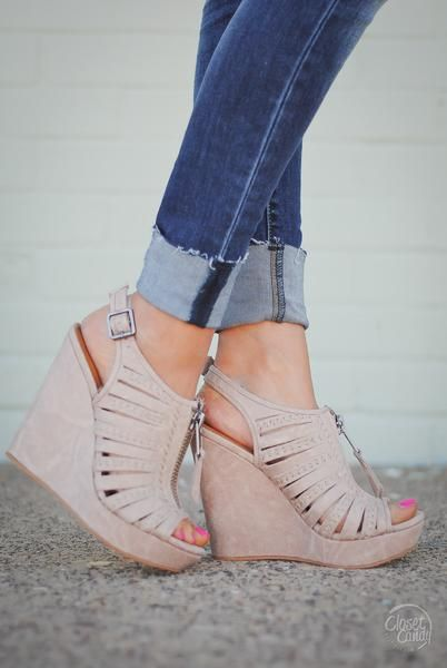 These neutral wedge sandals are the perfect addition to dress up your outfit! Vegan suede, zip-front wedge sandal with adjustable ankle strap and woven detail. Man-made materials. Approx. Measurements