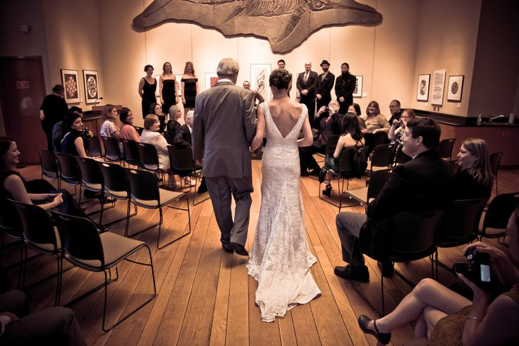 Where else can you walk up the wedding aisle towards a giant ichythosaur at your wedding ceremony but at the Burke Museum of Natural History and Culture? Photo by John Mitchell - Drumroll Studios