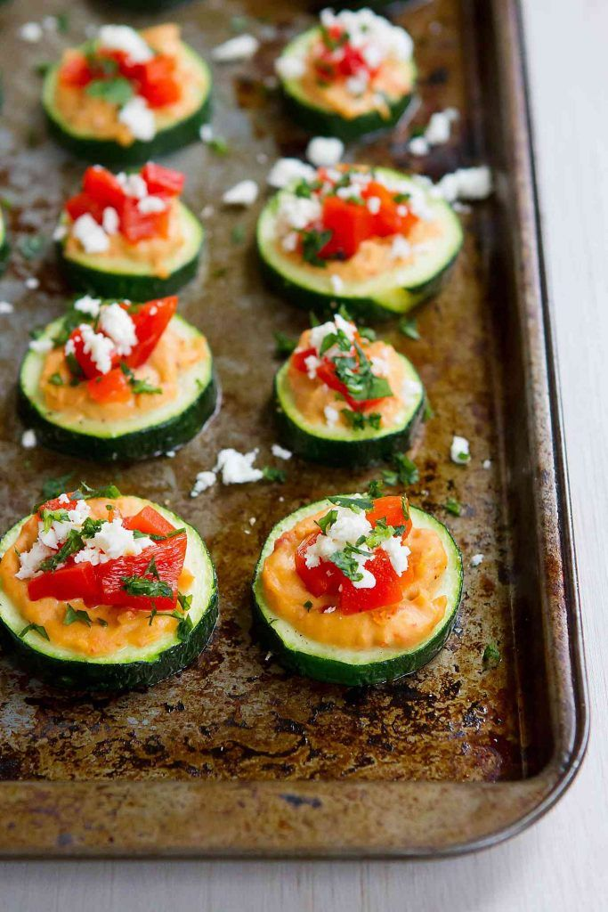 These Baked Zucchini Hummus Bites are fantastic for healthy snacking or appetizers! Only 39 calories for two of these vegetarian and gluten free bites.