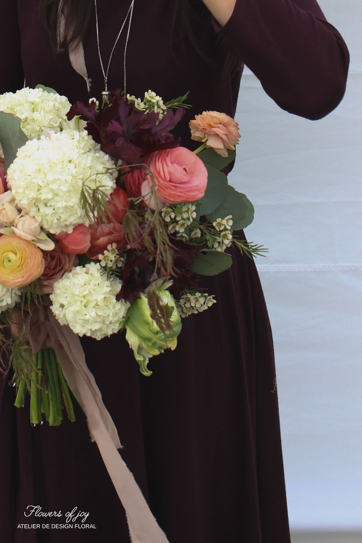 Ranunculus and viburnum bridal bouquet