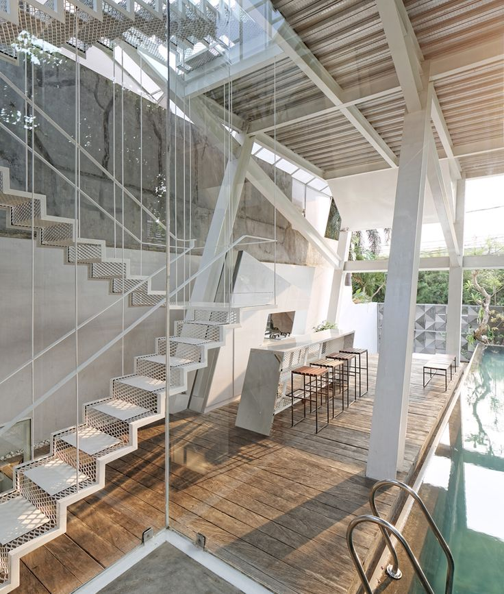 A Glass House Inside A Slanted Steel Frame in Jakarta - Gravity