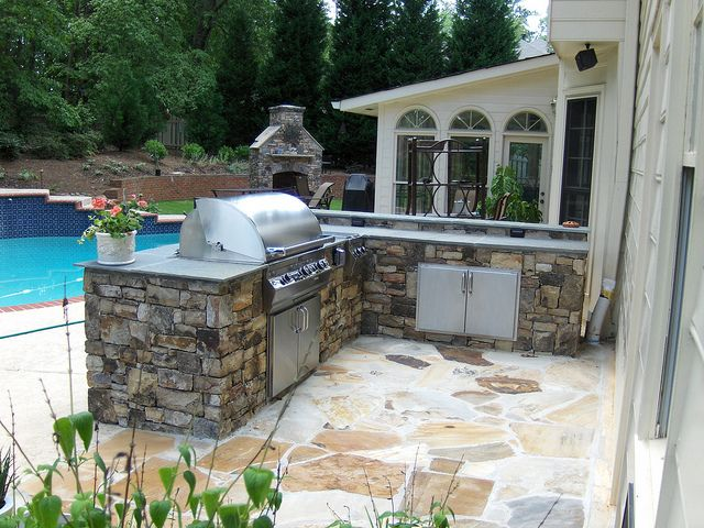 17 best images about outdoor kitchens and fireplaces on for Stone outdoor kitchen designs