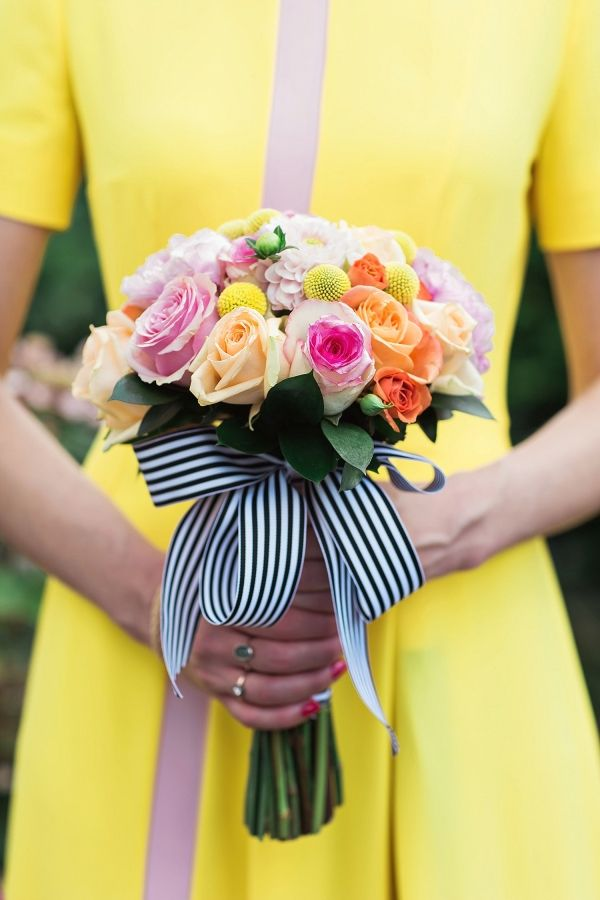 Colorful bouquet with a striped bow: http://www.stylemepretty.com/destination-weddings/2016/06/20/forget-white-this-bride-embraced-color-with-a-yellow-wedding-dress/ | Photography: Clean Plate Pictures - http://www.cleanplatepictures.com/