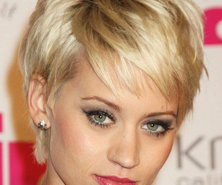 Wear your blonde hair within an edgy look like this woman with a side parting and messy layers.