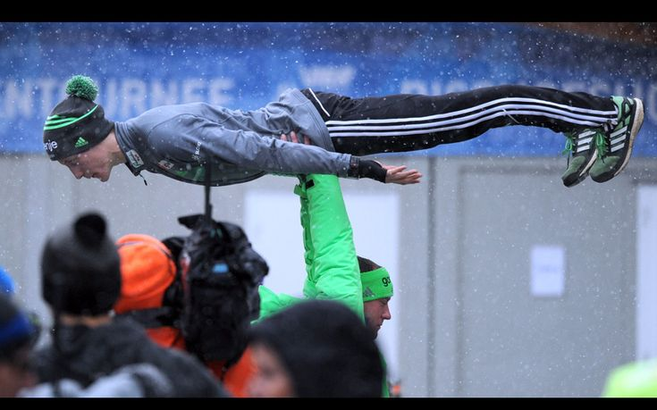 Peter Prevc of Slovenia limbers up ahead of the trial round at the fourth stage of the Four Hills ski jumping tournament in Bischofshofen, Austria