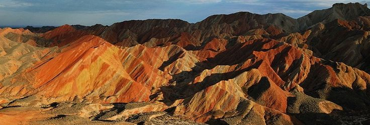Danxia Landform, China. The result of layers of red sandstone and minerals that was shaped by the exogenous forces like erosion and weathering as well as by tectonic uplift.
