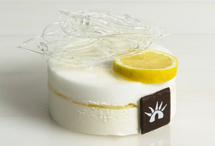 Semifreddo estivo - panna e limone: soft lemon semifreddo with a jam-rich heart, decorated with a sugar cloud.