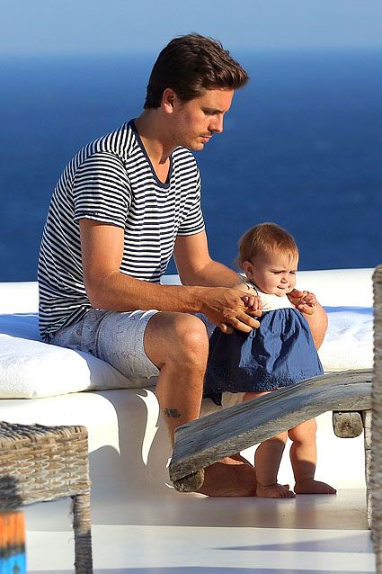 Daddy's little girl is walking! On May 1, 2013, Scott Disick was spotted spending some quality time with baby Penelope duri...