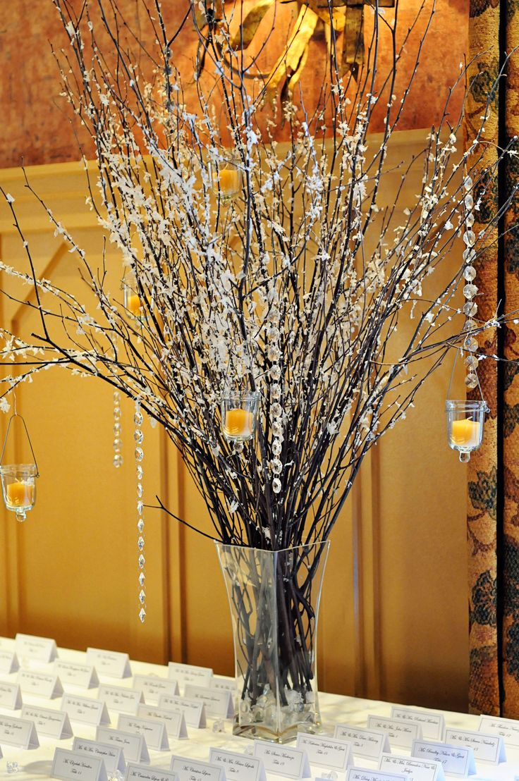 Winter wedding centerpiece with hanging candles
