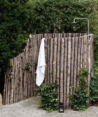 Outdoor Shower stall. I have always wanted one of these.  For when our hit is here