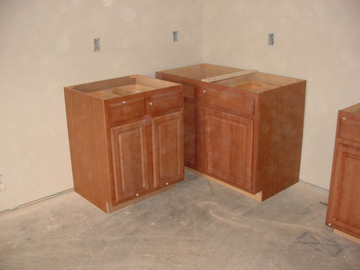 Pictures of stock prefab kitchen cabinet installation how for Cheap kitchen cabinets installed