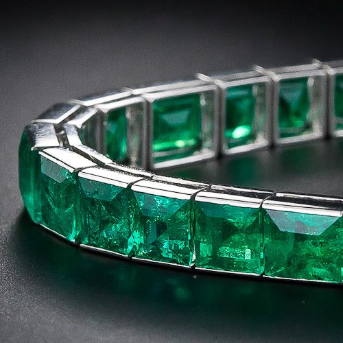 French Straight Line Emerald Bracelet: thirty-two square and rectangular rich vivid green emerald cut emeralds totaling eighteen carats.