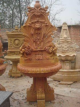 its used to red color of sand stone of marble used of hand made carving of wash basin