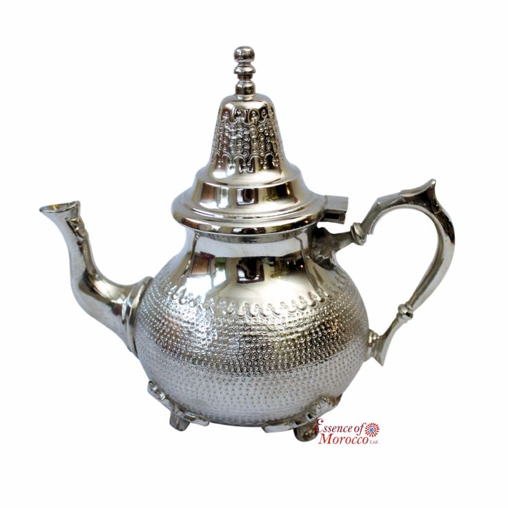 Vintage Moroccan Silver Teapot with history handmade and expertly hammered by Hand in the ancient imperial city of Fez Morocco known for its