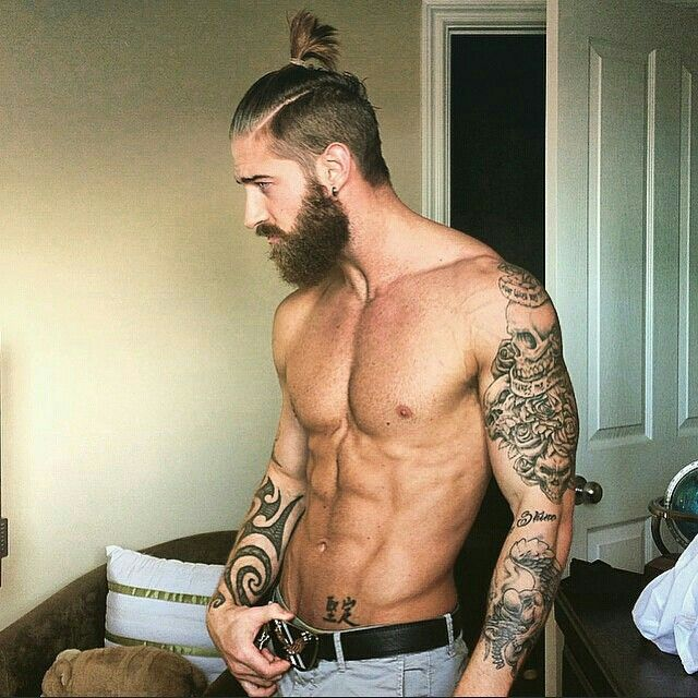 Beard and man bun there is a guy rocking this look at for Bearded tattooed man
