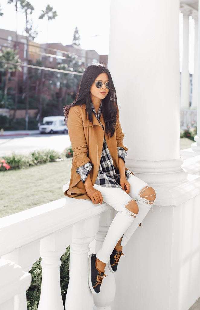 Plaid will never go out of trend! Sheryl Luke wears a simple black and white check shirt with distressed white jeans and a camel suede jacket, a great look for casual outings. Via Just The...
