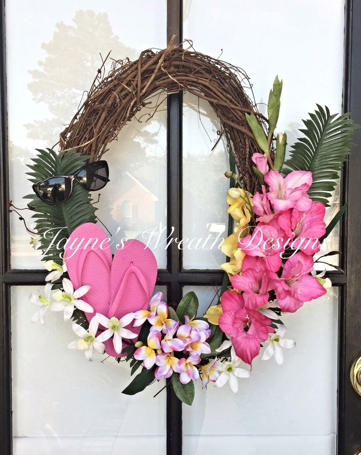 Oval Grapevine Wreath with Tropical Flowers, Flip Flops, and Sunglasses. This is a great wreath for a tropical beach theme. By Jayne's wreath designs on fb and Instagram