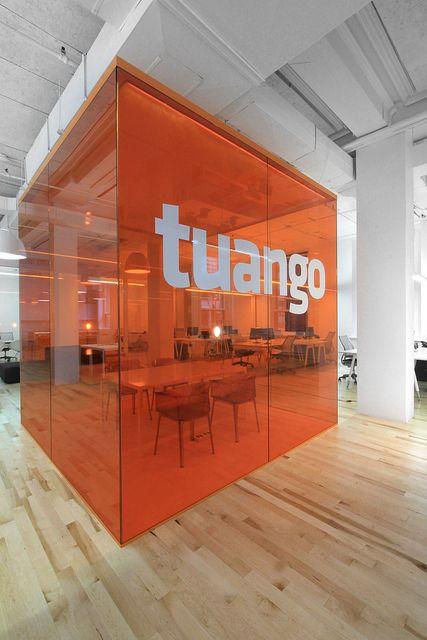 Transparent walls with color orange. Big logo.