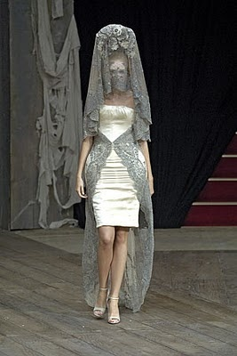 Alexander McQueen Spring 2007 RTW. Resembles the mantilla, worn to covver the hair, which was associated as a traditional Spanish costume.