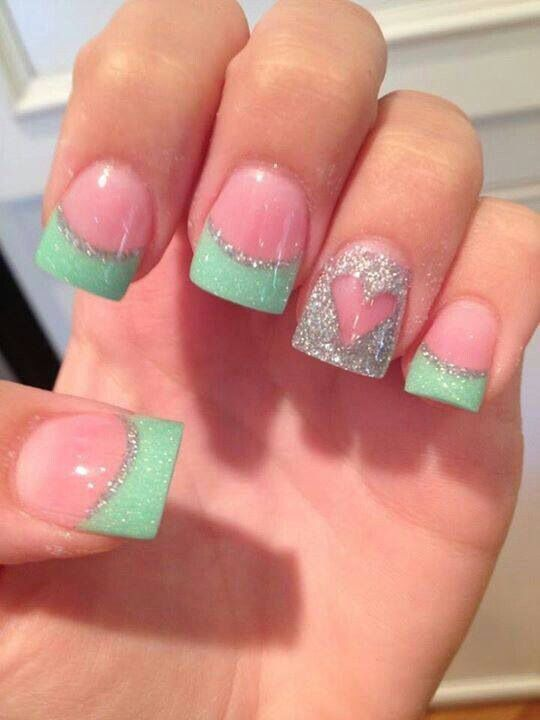 Sea green/mint acrylic nails glitter heart accent. Wider nails.
