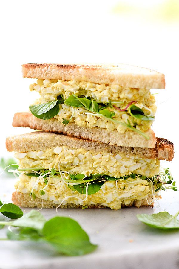 Curry and onion powder add an exotic heat to the traditional egg salad sandwich, making it fit for an every day breakfast, lunch or elegant brunch.