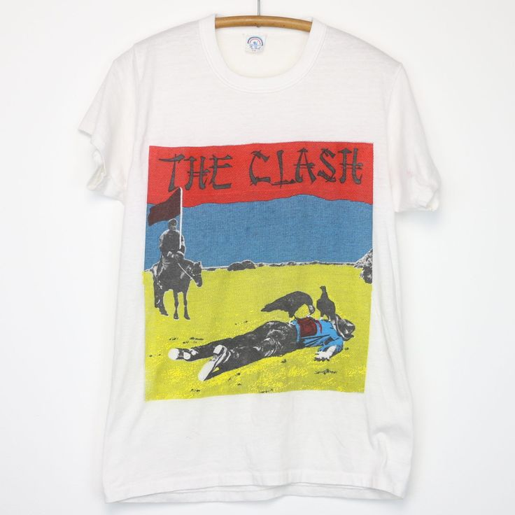 Original 1980s Clash Give 'Em Enough Rope Shirt. This is a true vintage shirt, not a modern reproduction. Sizes vary so please use measurements for best idea on fit. Front and Back Graphics. Shirt is in goodcondition, no holes, tiny mark on front.