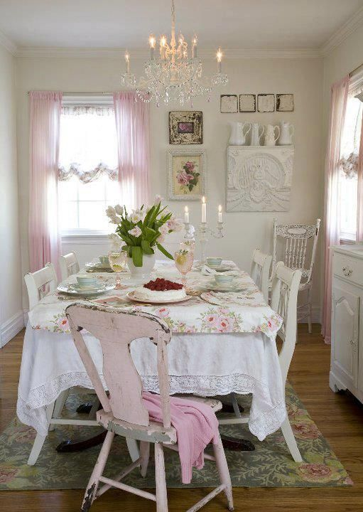Shabby chic dining room table setting with vintage linens painted chairs Chandelier flowers candelabra white pink cottage romantic