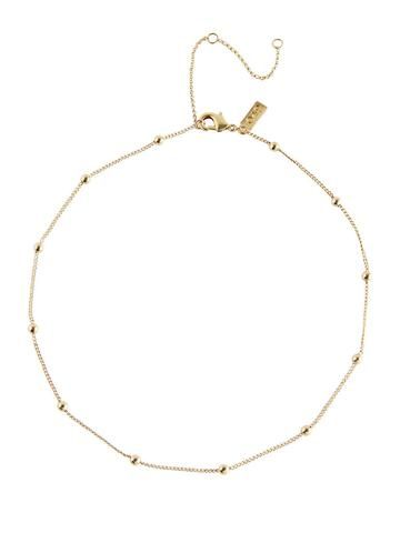 Simplicity at its best. This choker necklace features tiny gold beads for a delicately embellished look. Pretty on its own or layered with other necklaces. 12""