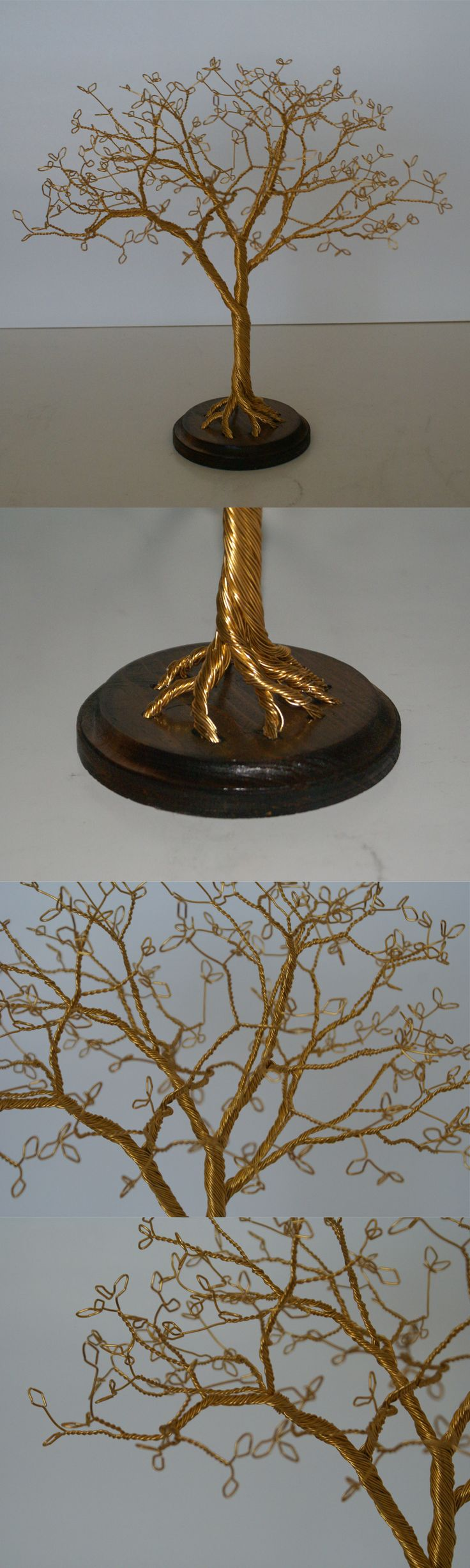 Wire tree I made. This time I drilled some holes in a wood plaque I got from the craft store and glued them in after staining and finishing the wood. I had fun with the leaves on this one. My dad says it looks like a fairy tree.