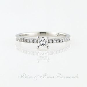 18k white gold ring with one 0.29ct Princess cut GH VS SI diamond with 16 = 0.16ct round brilliant cut diamonds micro set in the band. 1R06360