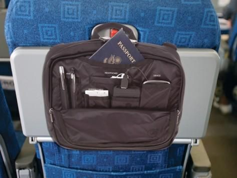 Innovative design that slips over the handle of your Carry On and wraps around airplane tray tables to store all your flight needs such as passport, charger, tablet and magazines right at your fingertips.