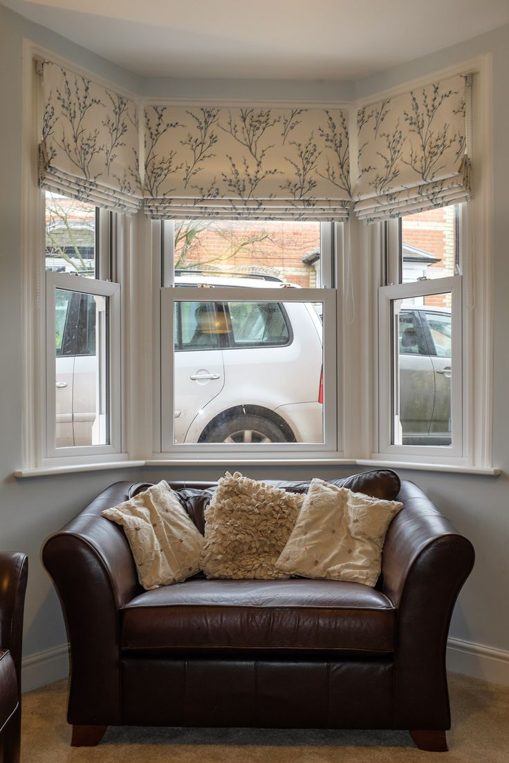 Three roman blinds to dress a bay window. The fabric is by Laura Ashley Pussy Willow off white/Seaspray. Bespoke Blinds by SauPing.