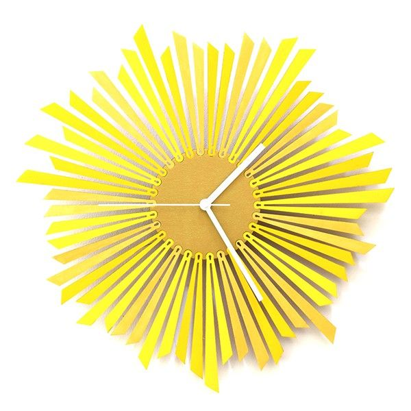 The+Sun+Wall+Clock+-+Bring+a+sense+of+warmth+and+light+to+your+interior+with+The+Sun+Wall+Clock+from+Ardeola!+This+yellow+contemporary+wooden+clock+is+wonderfully+designed+and+laser+cut+from+6mm+plywood,+giving+a+clean+and+stylish+look.  This+excellent+clock+features+a+gold+central+disc+that+houses+the+clock+mechanism+and+white+hands+and+each+ray+of+light+is+clamped+into+this+disc+in+a+such+a+unique+way+that+no+two+clocks+look+exactly+the+same…