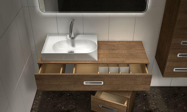 Noclaf Unico. W skłąd wchodzi umywalka OR40, konsola pod umywalkę SA25, kontener na ukrytych kółkach (pod umywalką), oraz słupek wiszący. Kolor H1151 Brown Authentic Oak, Uchwyt U11. Dodatkowo funkcjonalny organizer w konsoli.