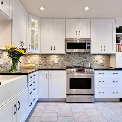White cabinets with the multi backsplash, dark counters and gray floor..my future kitchen for sure. so much space for activities!