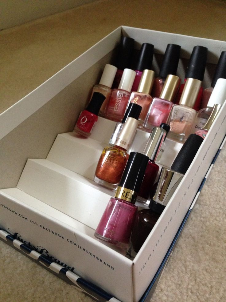 Shoe box nail polish storage solution.  Polish color is clearly visible and accommodates bottles of all shapes and sizes.  Stores neatly in a drawer out of sight.