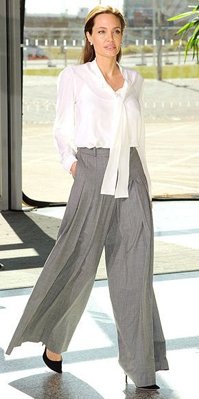 ANGELINA JOLIE Her Michael Kors separates left people divided yesterday, but Angelina gives it another go, selecting a white blouse and gray palazzo pants by the designer for the Global Summit to End Sexual Violence in London.