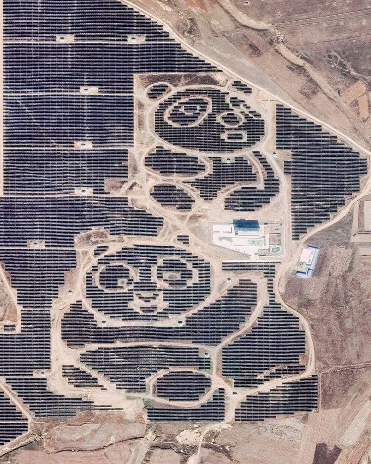 """Two pandas are formed by solar panels at the Panda Green Energy power plant in Datong, Shanxi Province, northern China. Built in cooperation with the United Nations Development Program, this solar farm covers roughly 1,500 acres and includes an education center that teaches children about sustainable and renewable energy.  Instagram: https://bit.ly/2Hpi6Xn  39°58'23.6""""N, 113°29'03.7""""E  Source imagery: DigitalGlobe"""